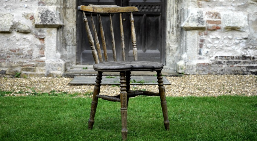 Wooden chair to be salvaged out on the lawn