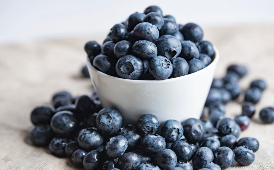 An overflowing bowl of fresh blueberries