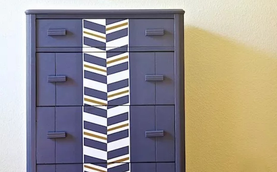 Chest of drawers painted in dark blue by Lost & Found