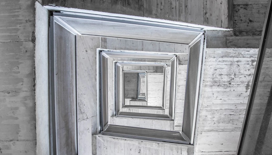 Looking up at different levels of a concrete structure