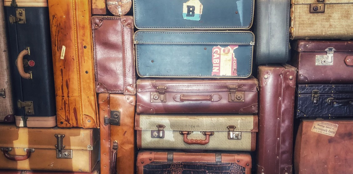 Piles of old vintage luggage bags
