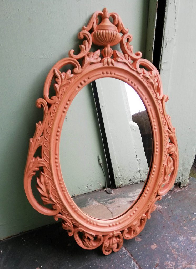 Ornate 1960s mirror in coral