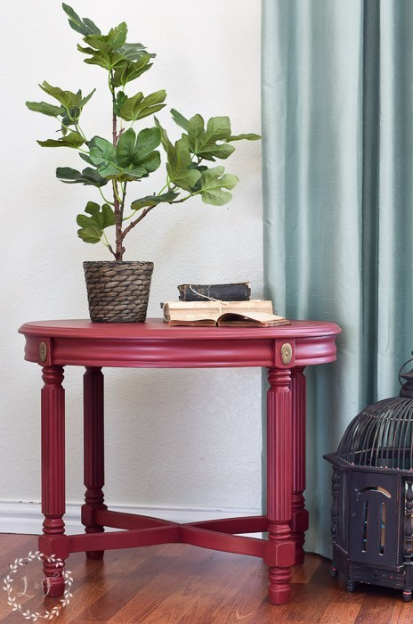 Cranberry colored side table