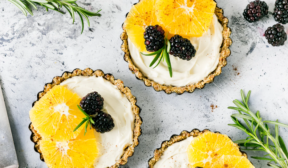 Fruit tarts with rosemary sprigs